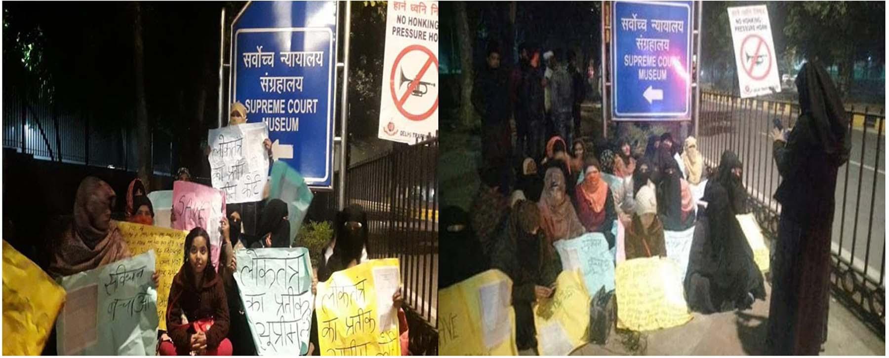 CAA पर फैसला आने से पहले रात को ही सुप्रीम कोर्ट के बाहर धरने पर बैठी महिलाएं।